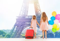 Two girls holding hands while walking around Paris Stock Photos