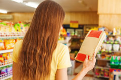 Back view portrait of a woman holding paper bag Royalty Free Stock Photos