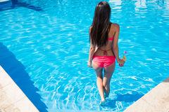 Back view portrait of a woman in pool Stock Photos