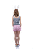 Back view portrait of a woman with rabbit ears Royalty Free Stock Image