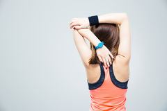 Back view portrait of a woman stretching hands Royalty Free Stock Photography