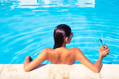 Back view portrait of a woman in swim pool Stock Image