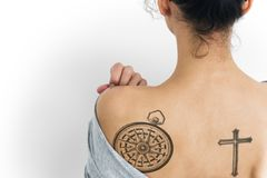 Back view portrait of a woman with a tattoo royalty free stock images