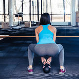 Back view portrait of a woman working out with weight royalty free stock photography