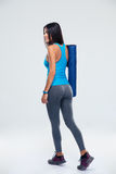 Back view portrait of a woman with yoga mat Stock Image