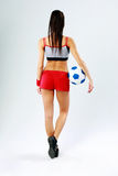 Back view portrait of a young woman standing with soccer ball Stock Photography