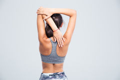 Back view portrait of a young woman stretching hands Stock Images