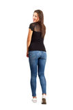 Back view posing casual brunette beauty. Full body length isolated over white Stock Photography