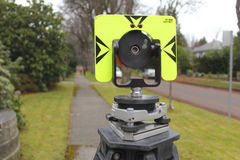 Back View of Prism. Back view of a surveyor's prism in an urban setting Stock Images