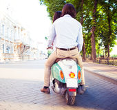 Back view protrait of a young couple on scooter Stock Photo