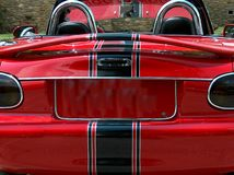 Back view of red convertible. A back view of a red convertible sports car with its licence plate blanked out Stock Image