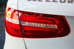 Back view and red headlight of white automobile Stock Photo
