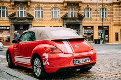 Back View Of Red Volkswagen New Beetle Cabriolet Car Parked In Street. Prague, Czech Republic - September 24, 2017: Back View Of Red Volkswagen New Beetle Stock Image