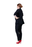Back view of redhead business woman contemplating. Royalty Free Stock Images