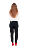 Back view of redhead business woman contemplating. Stock Photo