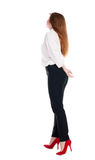 Back view of redhead business woman contemplating. Young girl in suit.  Rear view people collection.  backside view of person.  Isolated over white background Royalty Free Stock Photography