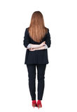 Back view of redhead business woman contemplating. Royalty Free Stock Image