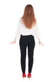 Back view of redhead business woman contemplating. Stock Images