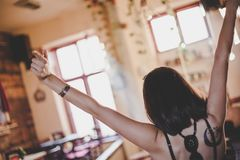 Back view of rejoicing girl at cafe stock photos