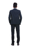 Back view of a relaxed business man looking away. On white background Royalty Free Stock Photography
