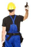 Back view repairman pointing up Royalty Free Stock Photography