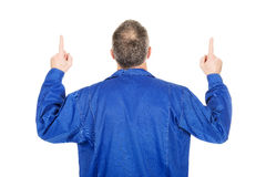 Back view repairman pointing up with both hands Stock Photography