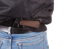 Back view of robber with handgun Royalty Free Stock Photos