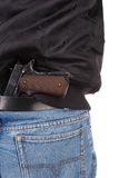 Back view of robber with handgun Stock Image