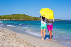 Back view of romantic couple at white beach with Stock Photography