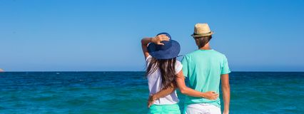 Back view of romantic couple at white beach during Royalty Free Stock Photo