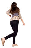 Back view of runing brunette girl. Stock Image