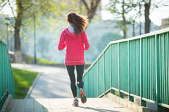 Back view of runner woman working out on the bridge Royalty Free Stock Photography