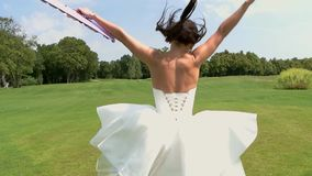 Back view of running bride. stock video