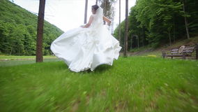 Back View of Running Bride. stock footage