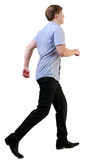 Back view of running business man Stock Images