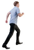 Back view of running business man Stock Photo