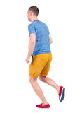 Back view of running man in t-shirt and shorts Stock Photography