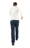 Back view of running man. Walking guy in motion. Royalty Free Stock Photos