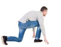 Back view of running man. walking guy in motion. Rear view peopl Royalty Free Stock Image