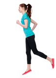 Back view of running sport woman. Royalty Free Stock Photos