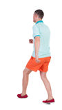 Back view of running sportsman. Stock Photo