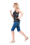 Back view of running  woman. beautiful blonde girl in motion. Royalty Free Stock Image