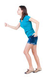 Back view of running  woman. beautiful brunette girl in motion. Royalty Free Stock Photo