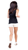 Back view of running  woman. Royalty Free Stock Image