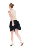 Back view of running  woman in dress Royalty Free Stock Photography