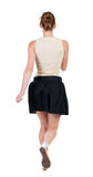 Back view of running  woman in dress Stock Photo