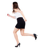 Back view of running  woman  in  dress. Royalty Free Stock Images