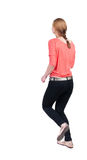 Back view of running  woman in jeans Stock Image
