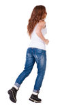 Back view of running  woman  in  jeans Royalty Free Stock Photography