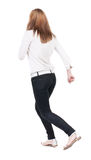 Back view of running  woman in jeans Stock Photo